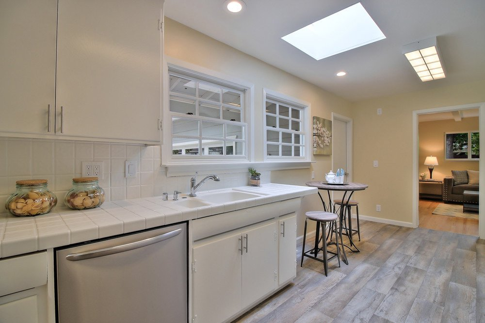 Another view of the kitchen after remodel - white finish