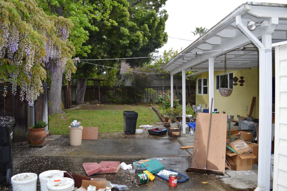 Backyard before cleanup: note clutter