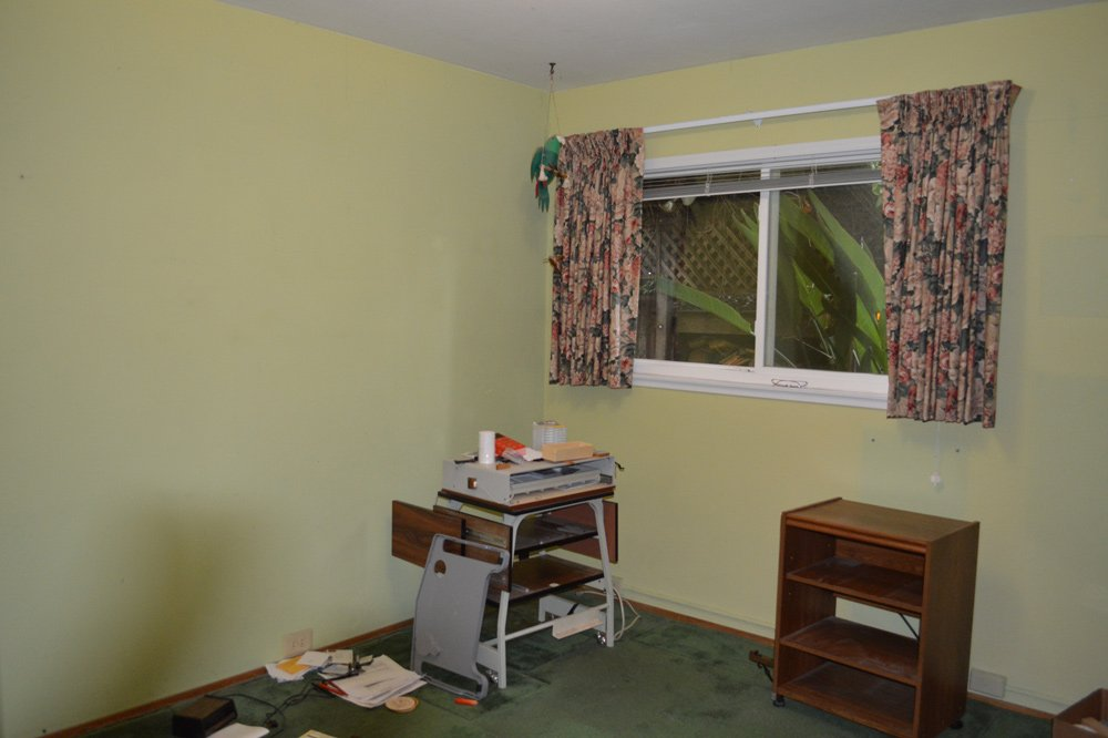 A bedroom used as office before cleanup