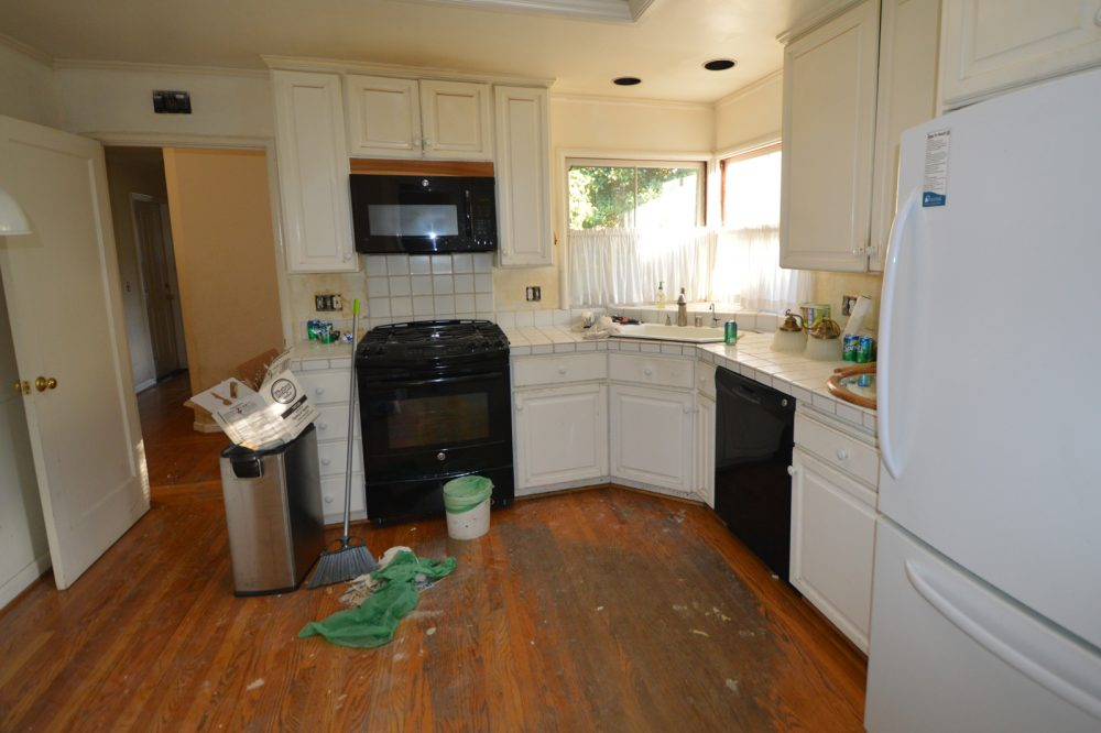 Kitchen before cleanup: note stained floor